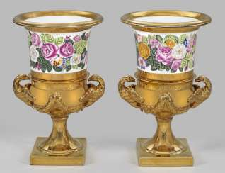 Pair of large ornamental vases with floral decoration
