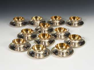12 silver cups with saucers.