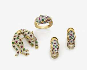 Parure consisting of a brooch, a Pair of ear clips and a Ring, in Panther form, with diamonds, rubies, sapphires and emeralds