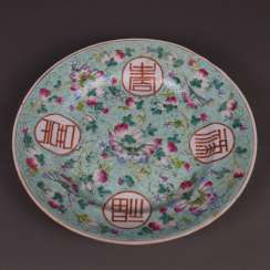 Plate with symbols of luck