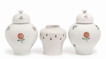 TWO LIDDED VASES AND A VASE
