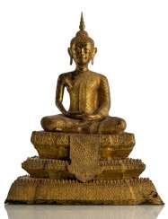 Bronze of Buddha Shakyamuni with red, black and gold colored paint version