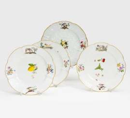 Three plates with animal and fruit decor