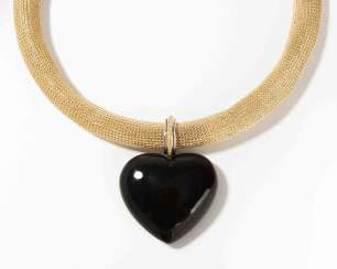 Yellow gold necklace with Onyx and diamond heart pendant