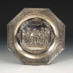 Silver plate with figure in relief