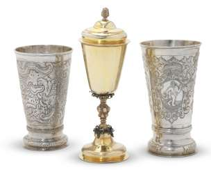 TWO SILVER BEAKERS AND A PARCEL-GILT SILVER CUP AND COVER