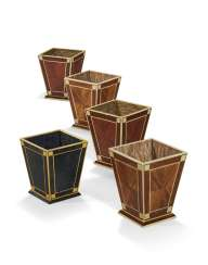 A GROUP OF FIVE FAUX AND CREAM PAINTED WASTE BASKETS