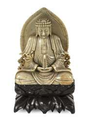 Soapstone carving of Buddha on a Pagoda holding