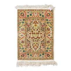 Small oriental carpet made of silk. HEREKE, 20th century, 70x47 cm.