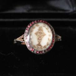 A SOUVENIR RING WITH THE HAIR WORK