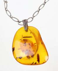 Amber pendant on silver chain