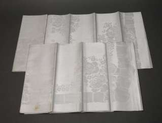 Couple of table cloths with rose decor