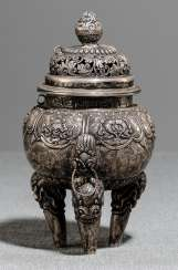 Incense burner, made of silver with Buddhist emblems and floral decor in Relief