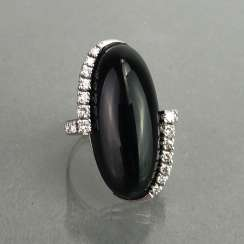 Fancy ladies ring with large Onyx 20 carats and brilliant-cut diamonds 0,64 carats. Gold 585 white.