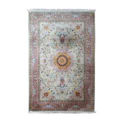 Oriental rug with silk. 20. Century, 305x203 cm.