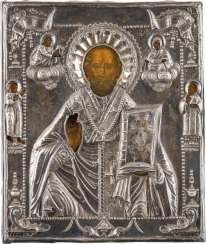 A SMALL ICON WITH ST. NICHOLAS OF MYRA WITH SILVER OKLAD