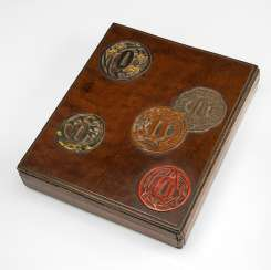 Lid box made of wood with decor of Tsuba part of iron and lacquer