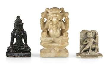 Three stone figures of Hindu and Buddhist deities, including Ganesha