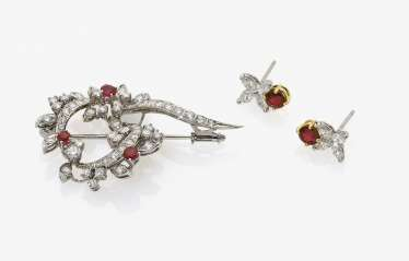 A Pair of earrings and a brooch with rubies and diamonds. USA, TIFFANY