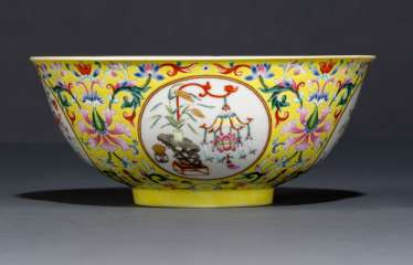 A fine 'Famille rose medallion porcelain bowl with yellow rear