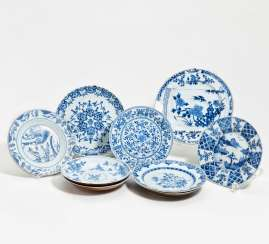 Ten blue and white plates with flowers and landscape