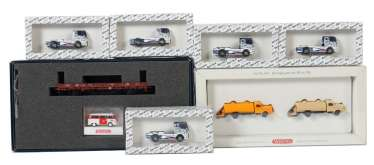2 model car sets and 5 Wiking racing trucks