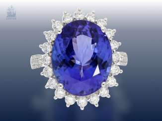 Ring: very classy, very high quality gold ring with tanzanite the best quality and rich, brilliant trim, unworn wrought