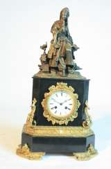 A clock with a bronze figure