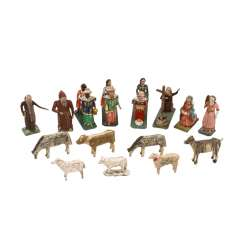 Group of twelve figures of the Nativity scene and the three theological, 19./20. Century,