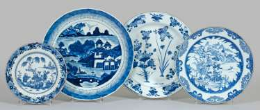 Four Blue And White Plates
