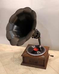 Antique gramophone with a black steel case made of carved wood, Russia, early 20th century