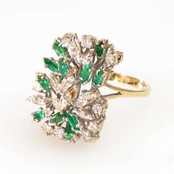 Lush ladies ring with emeralds and diamonds.