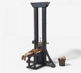 Model of a guillotine with a decapitated man