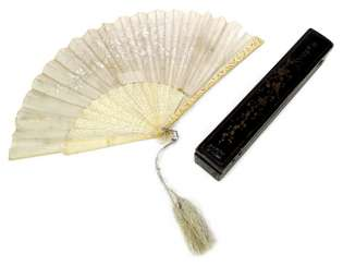 Fan with finely carved ivory ribs and cloth leaf in case