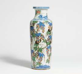 Vase with grapes and squirrels
