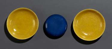 Pair of yellow glazed bowls with dragon decoration and powder blue glazed lidded box