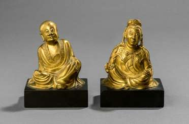 Pair of fire gilt bronze of a Lohan and a female seated lady