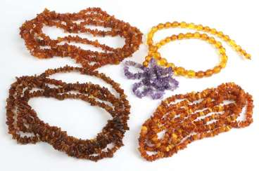 3 long amber necklaces, among other things,