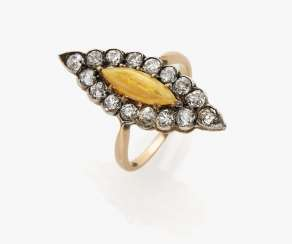 Marquis ring with an expressive fire opal and diamonds