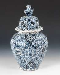 Faience lidded vase with blue painting.