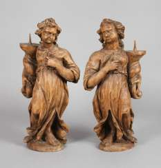 Pair of Baroque candlesticks angel
