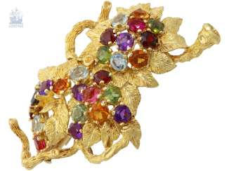 Brooch: very decorative and elaborately designed color stone brooch, in floral style, unique and crafted from 18K white Gold, around 1970, with value opinions