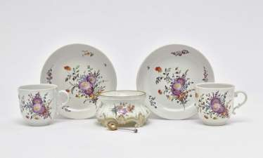 Two cups with saucers and Salière