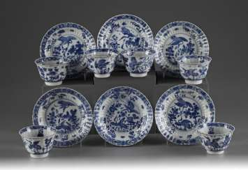 Six sets of blue and white cups and saucers