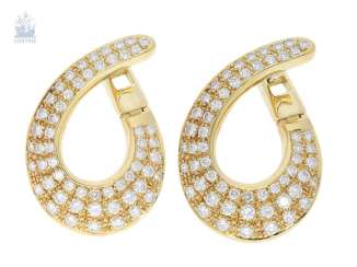 Stud earrings are extremely decorative, and formerly very expensive brilliant Designer stud earrings, crafted from 18K yellow gold, 2,93 ct