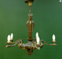 A large chandelier with oak base