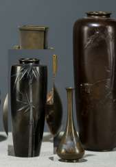 Three vases of Bronze, with the representation of a tiger, bamboo and herons