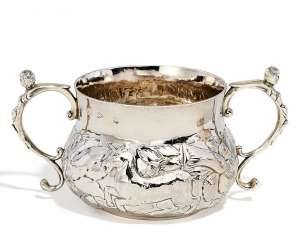 A small Charles II Porringer with a lion and a unicorn between flowers in relief. London