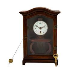 INTERESTING SMALL TABLE CLOCK IN DISPLAY CASE