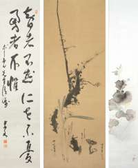Calligraphy and two paintings hanging roles